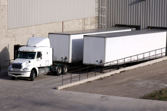 Trucks and trailers at docks