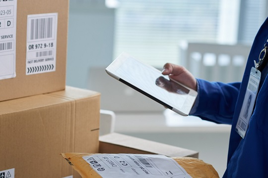 man reviewing parcel package